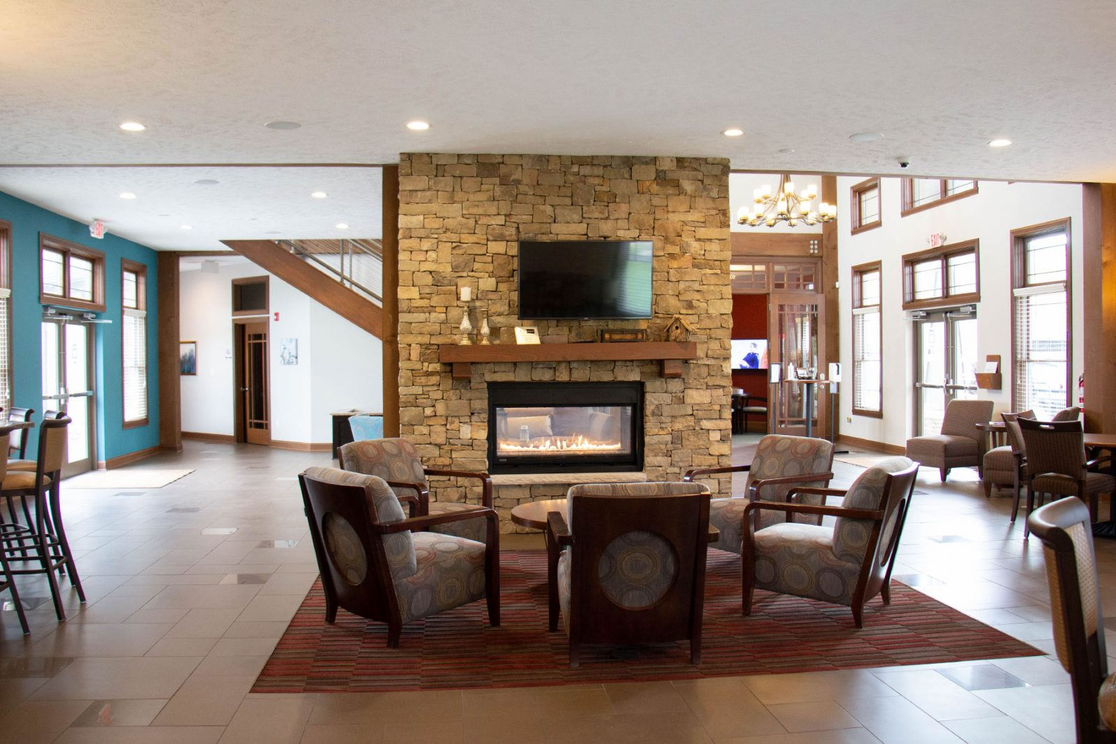 Clubhouse and lounge with flat screen TVs and work spaces | Amenities Bridgewater Apartments