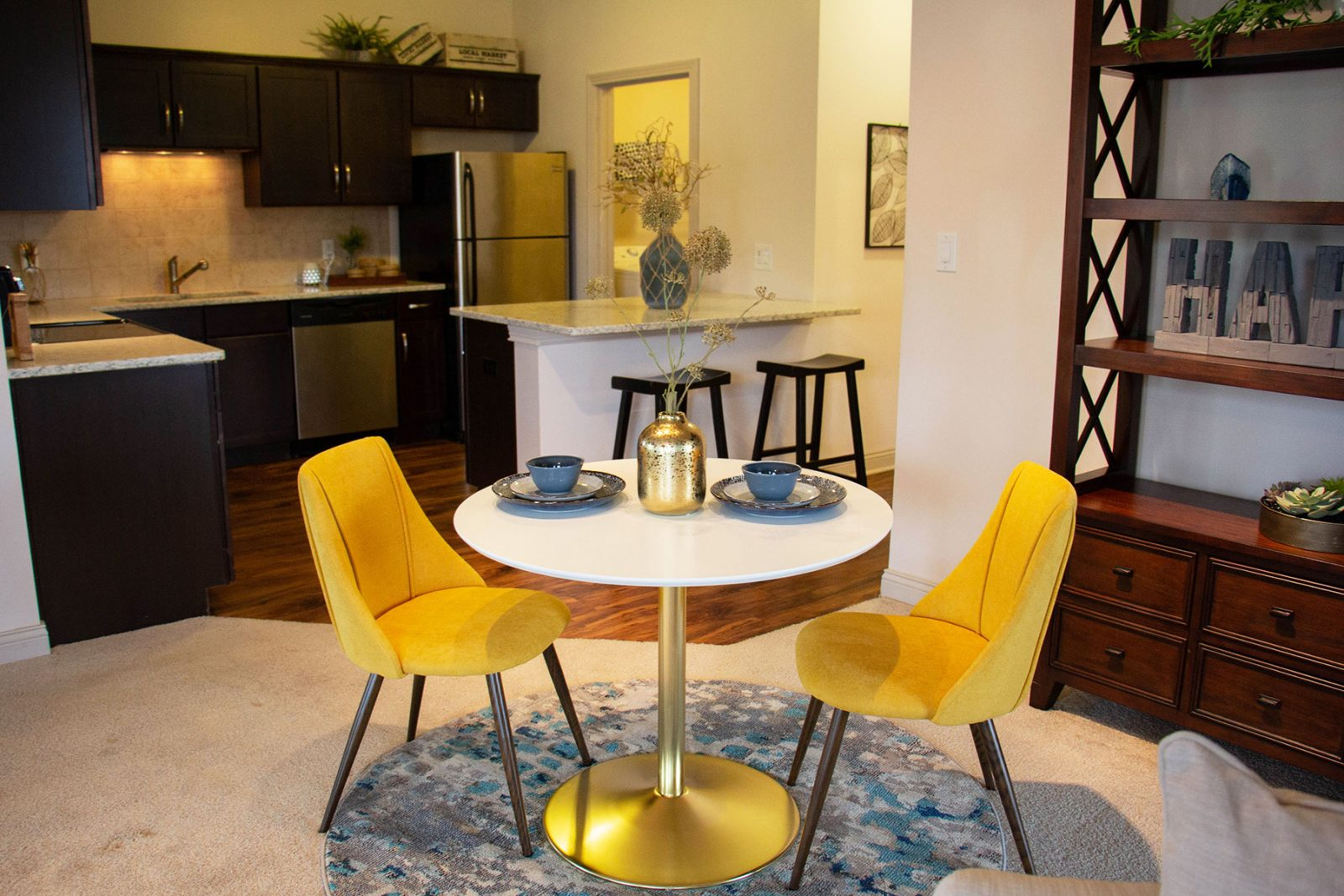 Spacious apartments with modern lighting fixtures and engineered wide hardwood flooring, private balconies and patios.